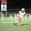 Javon Wilkerson returns a punt in a 44-13 loss to Mount Carmel during the Friday portion of the Big 8 Conference game.