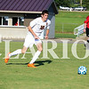 Trey Riggs competes against the Wood Memorial Trojans on Aug. 25. On Tuesday, Riggs scored a pair of goals for the Titans in a 3-1 victory over the Evansville Central Bears.