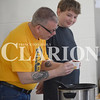 Rachel Graber Akpotu/Daily Clarion  <br /> Troy Elmore (right) and his son Simon make sure the cups containing their chili and chicken ministrone soups are drip-free at Sunday afternoon's Taste of Soup fundraiser in Oakland City.