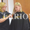 Quiche Matchen/ Daily Clarion<br /> Carolyn Bentley cuts Autumn Seals' hair at the annual back-to-school giveaway at Crossroads Baptist Church in Oakland City Saturday morning. Along with getting a backpack and school supplies, kids also got free haircuts.