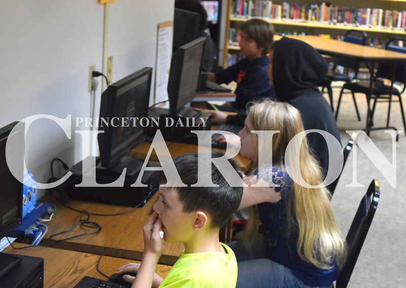 Jess Huffman/Daily Clarion<br /> From front to back, Jacob Fryrear, Grace Smith, Austin West and Chase West the video game Roblox at the Knox County Public Library Monday. The group and other area youth spent the summer filling up the ground floor of the library playing the game, youth director Emily Bunyan said.