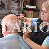 Jess Huffman/Daily Clarion<br /> Celia Enyeart, owner of Dean's Barber Shop, trims Francisco's Maurice Bolin's hair Tuesday. After 42 years at the same location, Enyeart will move her business at the end of the month.