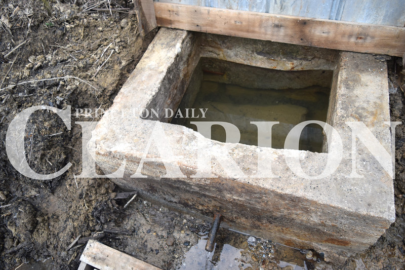 Jess Huffman/Daily Clarion<br /> A view into Dripping Springs, above, shows the structure that was unearthed by Owensville's Phil Scott and Steve Robinson Thursday.