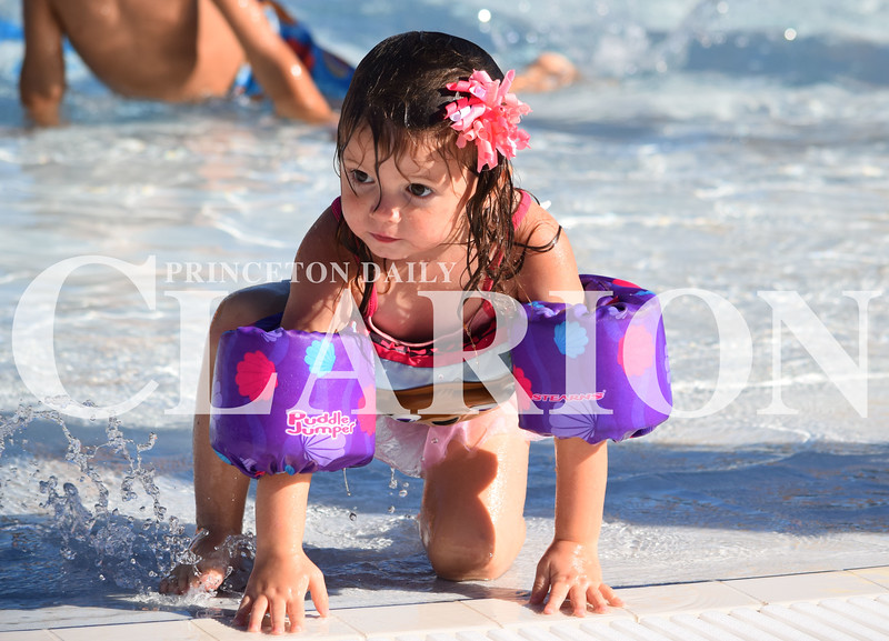 Quiche Matchen/ Daily Clarion<br /> Aizlee Bailey, 2, climbs out of the water at the Princeton Aquatic Center to get her goggles. Her mom said Saturday was the first time her daughter had used the goggles and she loved them.