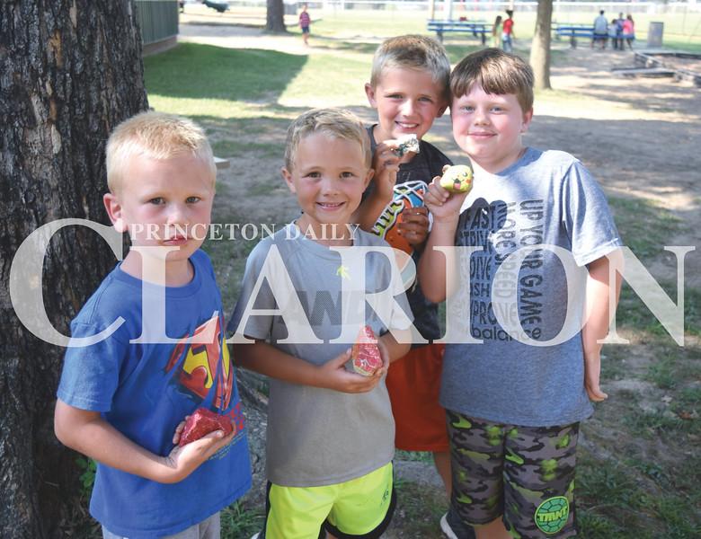 Quiche Matchen/ Daily Clarion<br /> James Blackburn, 6, Bentley Guiseyie, 6, Zen Coomer, 9, and Garrett Moseby, 8, find rocks at Lafayette Park Thursday evening.
