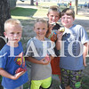 Quiche Matchen/ Daily Clarion<br /> James Blackburn, 6, Bentley Guiseyie, 6, Zen Coomer, 9, and Garrett Moseby, 8, find rocks at Lafayette Park Thursday evening.