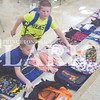 Quiche Matchen/ Daily Clarion<br /> Ian Eversole, 6, and Eli Eversole, 8, pick out backpacks at the annual backpack giveaway Wednesday afternoon at the Wood Memorial Jr./Sr. High School cafeteria.