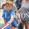 Quiche Matchen/ Daily Clarion<br /> Adrien Fox, 9, picks out a folder at the annual backpack giveaway Wednesday afternoon at the Wood Memorial Jr./Sr. High School cafeteria. Oakland City Hometown IGA gave away school supplies and a backpack to attendees.
