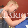 Quiche Matchen/ Daily Clarion<br /> Wyatt Stivers, 10, paints a rock with his sister Whitley and mom Niki Thursdays evening.