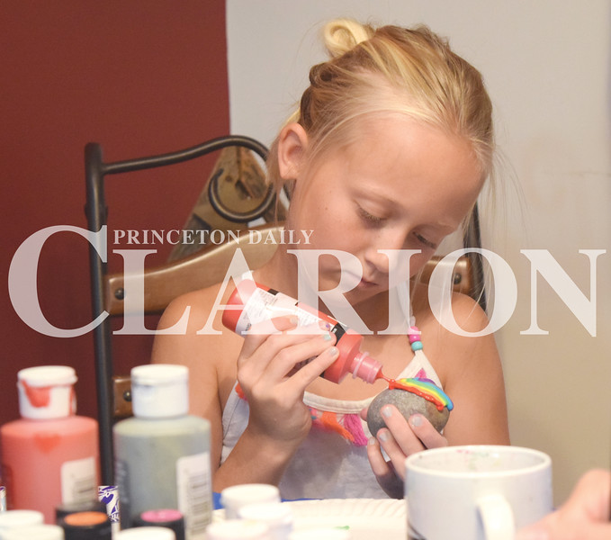 Quiche Matchen/ Daily Clarion<br /> Whitley Stivers, 8, paints a rainbow on a rock Thursday evening. Stivers, her brother Wyatt, 10, and mom Niki all sit at the table and paint rocks together.