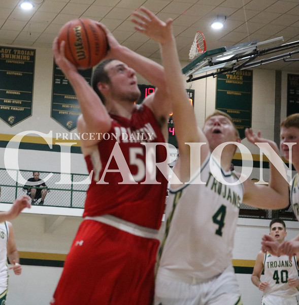 Lucas Whitten/Daily Clarion Archive<br /> Zach Dove battles for a layup at Wood Memorial High School earlier this season. On Tuesday, Dove recorded a double-double in a PCHS victory over Evansville Central.