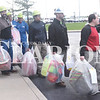 Quiche Matchen/ Daily Clarion <br /> Toyota Indiana team members line up to load presents into a semi Thursday afternoon. Team members donated their time and bought gifts for the 162 people they adopted this year.