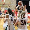 Lucas Whitten/Daily Clarion<br /> Lexi Lashbrook lines up a shot over three Lady Cardinal defenders on Thursday at Washington Catholic High School en route to a game-high 18 points.