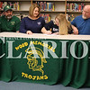Lucas Whitten/Daily Clarion<br /> Wood Memorial High School senior Kenzie Tooley signs her National Letter of Intent on Wednesday night, committing to play softball at Olney Central College. From left, WMHS head coach Fred Reel, mother Dawn Tooley, Kenzie Tooley, father Brian Tooley.
