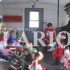 """Quiche Matchen/ Daily Clarion <br /> Conductor Dan Gilbert, St. Joseph Catholic School principal, reads the """"Polar Express"""" book to students Friday afternoon  at the Train Depot in Princeton. Kids also got to enjoy hot chocolate and cookies in their pajamas and meet Santa."""