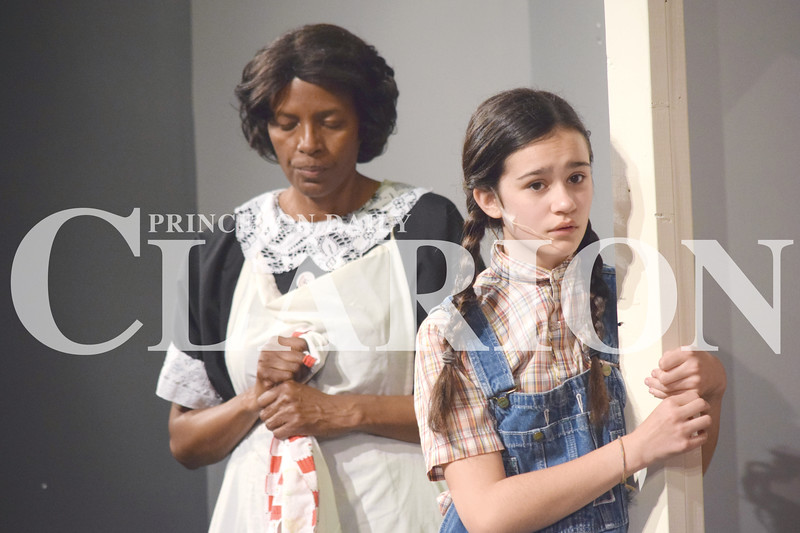 """Rachel Graber Akpotu/Daily Clarion archive<br /> Korinth Whetstone as """"Scout"""" and Donna Greer as """"Calpurnia"""" during dress rehearsal Tuesday night for the Broadway Players upcoming production of To Kill a Mockingbird."""