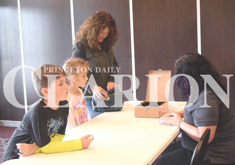 Quiche Matchen/ Daily Clarion archive<br /> <br /> Debbie Reneer takes her grandchildren Kaprice Tooley, 5, and Karter Summerville, 7, to one of the special family movie days  at the Princeton Theatre and Community Center.