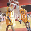 Princeton's Zach Dove (50) puts up a shot in the paint during boys high school basketball against Pike Central.