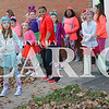 Daily Clarion/Andrea Howe<br /> The Dancing Tigers of New Image Family Fitness practice their moves while waiting for Saturday's Christmas parade to start.