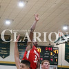 Lucas Whitten/Daily Clarion Archive<br /> Stephan Wilkerson lets go of a floater over two Wood Memorial defender earlier this season at Wood Memorial High School. On Tuesday, Wilkerson stayed hot with a 25 point game in a PCHS victory over Evansville Central.