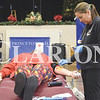 Quiche Matchen/ Daily Clarion <br /> <br /> Tara Seitz of Red Cross preps Tamika Liebhart's arm to give blood Tuesday afteernon. Liebhart has gotten her blood drawn around 14 to 15 times prior to Tuesday afternoon.