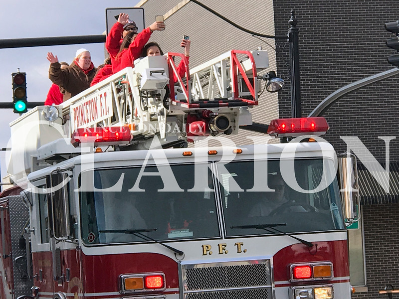 "Daily Clarion/Andrea Howe<br /> <br /> Fire truck escort<br /> <br /> Princeton Community Middle School Eighth Grade Lady Tigers basketball squad celebrates a conference championship with a fire truck escort through Princeton Saturday. While the weather was a little brisk, the team enjoyed taking ""selfie"" shots aboard the ladder truck as Princeton Fire Territory crews approached the Gibson County Courthouse square."
