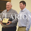 Quiche Matchen/ Daily Clarion <br /> <br /> Don Sollmon of Haubstadt was awarded the Conservation Farmer of the Year at the Gibson County Soil and Water Conservation District's 70th annual meeting last Thursday. Matt Michel of GCSWCD presented Sollmon with a plaque and jacket.