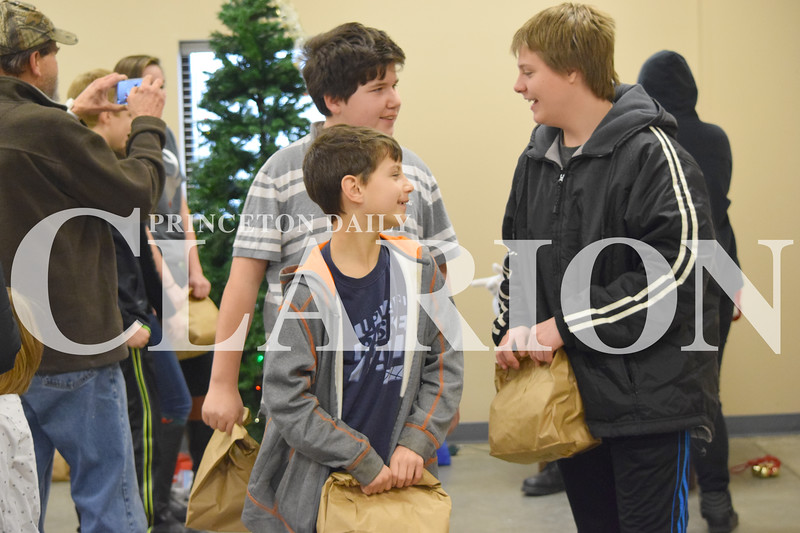 Rachel Graber Akpotu/Daily Clarion<br /> Levi Spicer, Gunnar Dockery and Xavier Ernst leave with goody bags after visiting with Santa Saturday afternoon during the 89th annual Fort Branch Community Treats for Kids event.