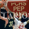 Daily Clarion/Andrea Howe<br /> Trojan Paxon Bartley goes to the hoop as Tiger Maleek Hardiman tries to block the shot.