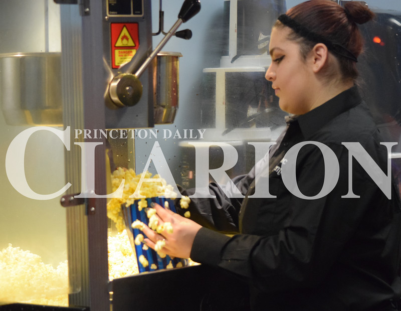 At the movies...<br /> Rachel Graber Akpotu/ Daily Clarion <br /> Mercedes Milbradt scoops popcorn in preparation for the after Christmas Day rush Monday afternoon at Showplace Cinemas movie theater in Princeton.