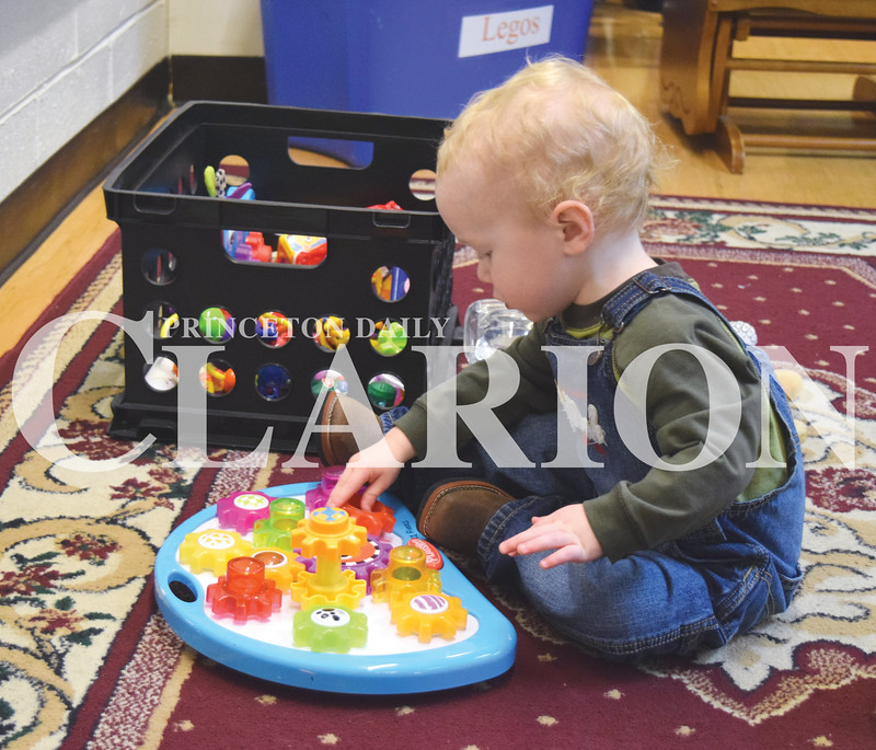 Quiche Matchen/ Daily Clarion <br /> <br /> Jace Spencer, 1, plays with toys while his sister makes different shapes out of Magformers at the Princeton Public Library Thursday afternoon.