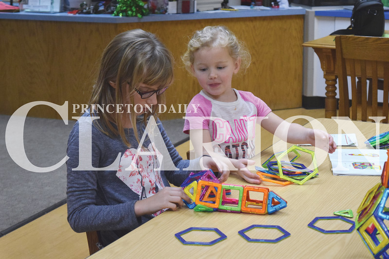 Quiche Matchen/ Daily Clarion <br /> <br /> Laura Black, 12 and Jayden Spencer, 4, make different shapes out of Magformers at the Princeton Public Library Thursday afternoon.