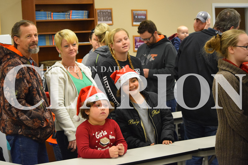 Rachel Graber Akpotu/Daily Clarion <br /> From left, Steve Miskell, Star Miskell, Jadalynn Henderson, Kendra Miskell and Samantha Miskell wait in line at the Fort Branch Community Treats for Kids event held at the fire station Christmas Eve afternoon. Annually, around 300 people attent the event.