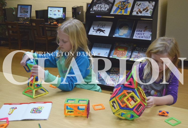 Quiche Matchen/ Daily Clarion <br /> <br /> Sarah Black, 10, and Kaylee Black, 7, make different shapes out of Magformers at the Princeton Public Library Thursday afternoon.