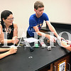Daily Clarion/Andrea Howe<br /> Science teacher Heather Ota watches summer STEM camp students Cade Hurt, Evan Marsh and Rugar Jenkins work through a team challenge to create a security alert device.