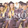 Quiche Matchen/ Daily Clarion<br /> Gibson Southern High School Valedictorians Samantha Bittner and Cora Blume, and Justin Brown clap for their classmates as they take the stage to receive their diploma at Friday night's graduation ceremony.
