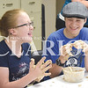 Quiche Matchen/ Daily Clarion<br /> Nate Austin, 13, and Larissa Pohl, 14, laugh as they try to get the dough off of their hands. Gibson County 4-H food science frenzy participants learned how combining flour and water creates dough Tuesday morning.