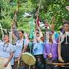Haley Church/Mount Carmel Register<br /> Walkers stand with their fists raised during a traditional Native American song that honors women, who are considered the backbone of the group. The walkers staged at Wabash Valley College Monday morning, then drove to Princeton, where they walked east on Broadway from the courthouse square, en route to English.