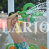 Rachel Graber Akpotu/Daily Clarion <br /> Karter Earl, 4, soaks up some sun while spraying water off of the aquatic equipment at the Princeton City Pool Memorial Day afternoon. The pool and splash park are open daily throught the summer.