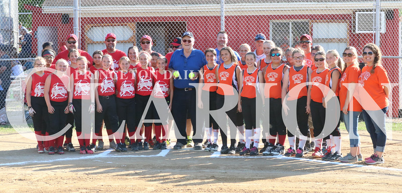 Lucas Whitten/Daily Clarion<br /> <br /> Denny McLain and the Princeton (left) and Ft. Branch (right) softball teams on Friday at Jack Bishop Ballpark. Prior to the game, McLain threw out the first pitch and was given signed softballs by both teams.