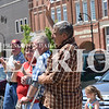 Rachel Graber Akpotu/Daily Clarion <br /> Veteran Marine Larry Meadows raises his hand while servicemen and servicewomen are recognized at Monday mornings Memorial Day ceremony at the Courthouse gazebo.