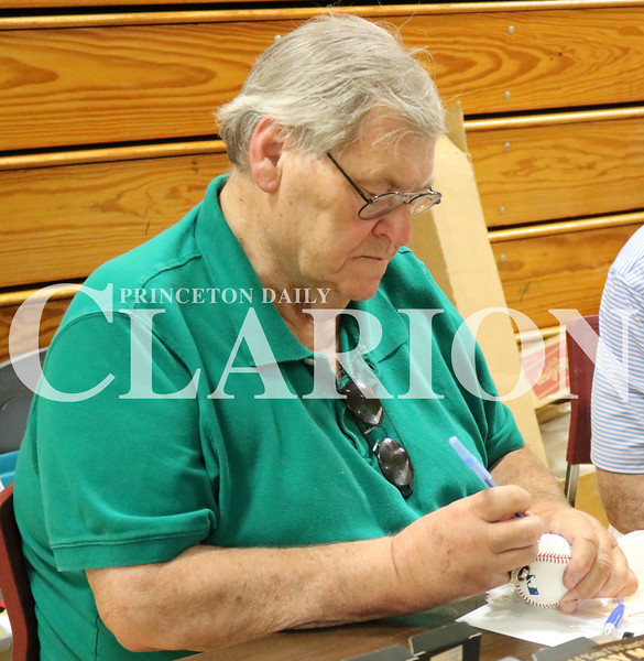 Lucas Whitten/Daily Clarion<br /> <br /> Denny McLain signs a ball at Fort Branch Community School on Saturday during a fundraiser for both Princeton and Ft. Branch Softball.