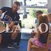 Quiche Matchen/ Daily Clarion<br /> Evansville Otters baseball player Kyano Cummings reads a book to Natalie Bonham, 9, Rylan Weber, 6, and Sam Bonham, 6 Tuesday morning at the Haubstadt Library.