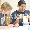Quiche Matchen/ Daily Clarion<br /> Isabelle Overton, 14, and Rachael Emberson, 14 put their dough in water to see how it changes. Gibson County 4-H food science frenzy participants later on that day they made pretzels and muffins.