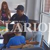 Quiche Matchen/ Daily Clarion<br /> Evansville Otters baseball player Jason Broussard reads a book to Natalie Bonham, 9, Rylan Weber, 6, and Sam Bonham, 6 Tuesday morning at the Haubstadt Library.