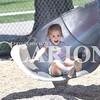 Quiche Matchen/ Daily Clarion<br /> Journi Falls, 5, laughs as she slides down the slide at the Lions Kiddie Land Park in Princeton Wednesday afternoon.