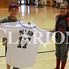 Lucas Whitten/Daily Clarion<br /> Christian Bigham (left) and Payten Adams (right) hold an autographed Denny McLain jersey that lists career achievements in the numbers at Ft. Branch Community School on Saturday.