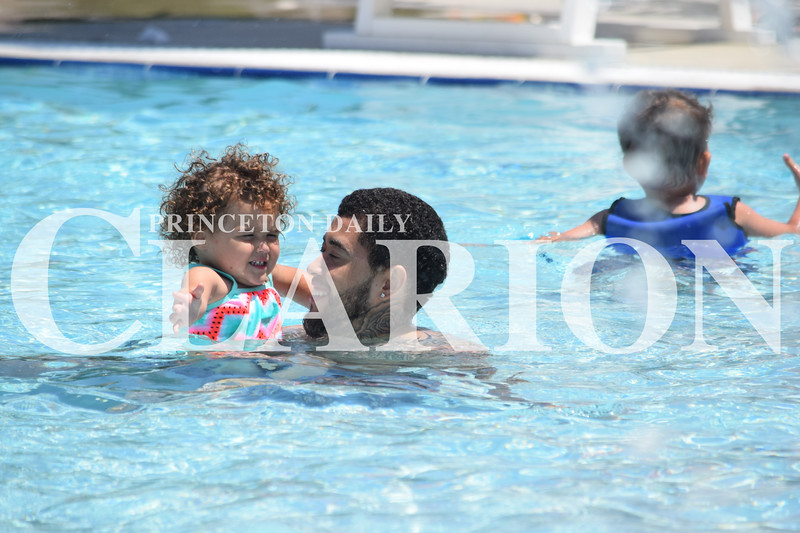Rachel Graber Akpotu/Daily Clarion <br /> Kayzlyn Bradshaw gets used to the water with her uncle Antony Davis Monday afternoon at the Princeton City Pool which opened Memorial Day weekend.
