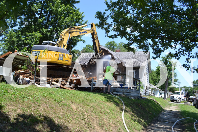 Photo Provided <br /> Kerry Wilhite of Wilhite Excavating in Francisco demolished a property at 933 S. Race Street Friday after being deemed unsafe in March of 2016 by the city of Princeton.