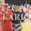 Quiche Matchen/ Daily Clarion<br /> Princeton Community High School life skills teacher Sara Reynolds walks with PCHS graduate Noah Clark to get his diploma at Saturday's commencement ceremony.